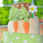 carrot cake themed topsy turvy diaper cake